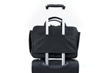 The Air Porter—rolling suitcase handle pass-through