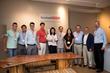 InTeahouse CEO Xin Liu celebrating iSoftStone partnership