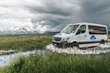 Traveling comfortably in Mercedes-Benz Sprinter custom safari vehicles, Wildlife Expeditions guests explore Yellowstone in style, popping open the roof hatch for spectacular views (photo by Orijin Med
