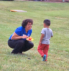 Ryan Drigo, Assistant Branch Manager, Springfield Town Center, takes a break from delivering lunches to play catch with a youth.