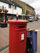 Gnome UK photographed on top of an English postbox in Bicester, England by his volunteer travel companion Alison.