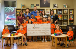 Stepping Stone School Students' present a check to Ronald McDonald House Charities of Central Texas for $12,860.14