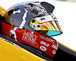 The children's silhouettes from Mercy Home's logo are placed on each side of the helmet almost tracing Graham like he is racing with them.