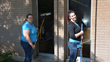 Two collaborators bring some light to the rooms at OWCAP-Head Start by cleaning the windows.