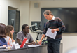 Syracuse University School of Information Studies faculty member Kevin Crowston instructs a graduate class.