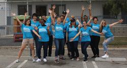 Smile Brands and Smiles For Everyone volunteers help distribute backpacks in Costa Mesa