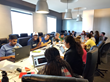 Summer Academy of Code - Los Angeles students working through coding challenges