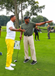 Jalen Rose and Ron Harper on the first tee at Detroit Golf Club for The Jalen Rose Golf Classic