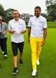 Jalen Rose and David Jacoby walk to the green at The Jalen Rose Golf Classic at Detroit Golf Club