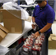 Hospital Services employee Joey Abascal  prepares a shipment of red blood cells from the South Texas Blood & Tissue Center.