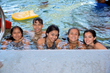 Children swimming at Calvary's Camp Compass®.