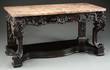 Carved Rosewood Side Table with Marble Top realized $27,225.