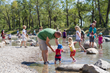 "The Civitas/W design reintroduced water to the island through a new stream and wetland to engage visitors with the river's natural dynamic processes, including this shallow waterplay area known as ""Th"