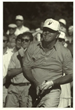 Arnold Palmer wearing a a Hanna Boys Center hat in tournament play.