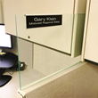 Custom office name plates and holders for glass cubicle walls