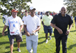 Marcus Allen (L) and Charles Barkley (R) make their way from 18 Green to the Clubhouse after the Erving Playoffs at The Ace Club