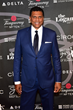 Reggie Theus walks the red carpet at The 2017 Erving Black Tie Ball and Pairings Party in Philadelphia wearing a custom JB Clothiers suit