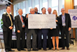 Association Management Group Leaders Present $100,000 Check Representing Efforts of 60 Sponsors and 1,200 Runners Working Together To Help Fight Hunger in the Triad