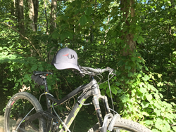 JA Benefits hat on mountain bike