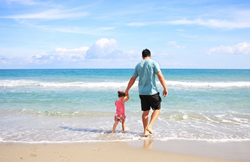 Father and daughter on the beach