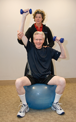 senior adult lifts weights