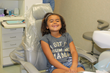 Child smiling in the dental chair