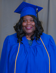Ultimate Medical Academy Graduate Sabrina Leftwich poses at commencement.