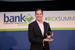 Chad Bruhn, Vice President of Sales at NCR, accepted the award for Best ATM / Self-Service Experience.