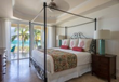 Master bedrooms with king beds have a view of Grace Bay.