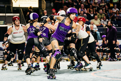 Rose City Rollers Jammer Bonnie Thunders escapes the pack at the 2017 International WFTDA Playoffs in Seattle, WA. Photo Credit: Ben Mah