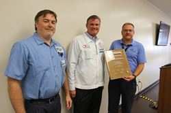 F.I.T. Inc. receiving Excellence in Delivery Award from Honda representative