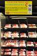 A grocery store meat case full of SaniTrace labeled prewrapped packages of ground beef.