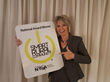 Marcie Boener, WCCTA, proudly showing off their new sign as a SMART RURAL Community.