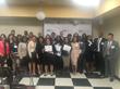 """AHC's Financial Careers Training Program graduates showcase their new credentials."""