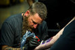 Tattoo artists participated in the Raleigh Tattoo Festival, a charity event held at Ray Price Capital City Bikefest.