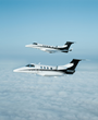 An Embraer Phenom 100 and Phenom 300 in the Executive AirShare fleet