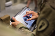 An unidentified US Army soldier uses the SmartRayVision X-Ray System interface.