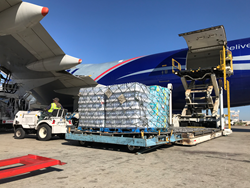 Cargo airplane loading water for FEMA hurricane Maria relief delivery