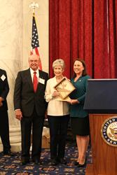 Glenn and Scarlett Riley receive award from Congressman Martha Roby