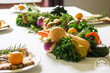 Photo of a centerpiece made of fresh produce.
