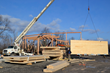 A cross laminated timber (CLT) panel is 'flown' into place during construction of New Energy Works CLT building.