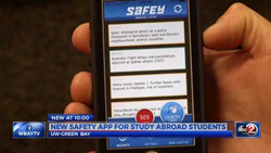Handheld smartphone featuring SAFEY app on screen, ABC news affiliate station in Green Bay Wisconsin