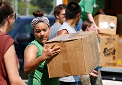 Volunteer Allison Baptiste helps unload a truck of supplies at a distribution point in the Dickinson ISD Community Gym in Dickinson, Texas on Friday, Sept. 1, 2017 in the wake of flooding caused by Hurricane Harvey.