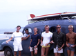 Robert August, Terrance Bullen, Mike Hynson, Jack Wilson, Max Wetland, and Terrance's friend James parked at the beach after surfing in South Africa.