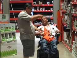 Lebron assists a customer in Home Depot.