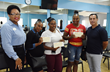 Patricia Vlaun, Human Resources Manager(far left) and Sergio Porcasi VP of Casino Royale Operations (far right) hand out vouchers to employees