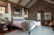 """A bedroom by WRJ Design, rich with textures and a custom handcrafted bed, is highlighted in the new book """"Rustic Modern"""" (photo by Audrey Hall)."""