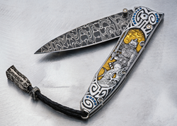 Hand-engraved and inlaid with 24K gold and sapphires.