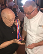 Woody Williams presents Celebrity Chef Robert Irvine with Honorary Board Member Medallion