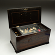 Music Box With Bells, Bird Clappers, and Dolls, estimated at $2,000-4,000.